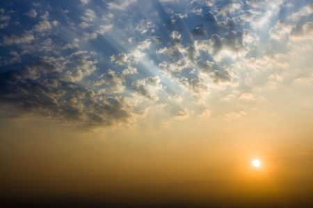 Background with sun rising and clouds Stock Photo