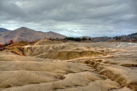 Dramatic landscape of muddy volcanoes in Romania