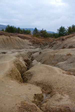 Dramatic landscape of muddy volcanoes in Romania photo