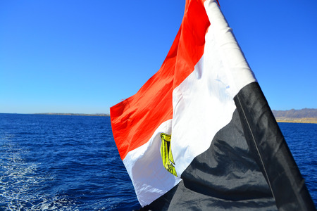 Egyptian flag on the background of the Red Sea. Flag of Egypt on background of sea and Tiran island 写真素材
