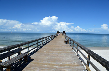 horrizon: This is a photo of a pier appearing to lead to clouds on the horrizon