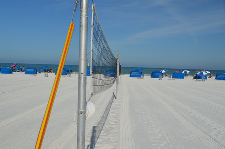 A linear photo of two beach volleyball nets