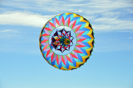 This is a photo of a sombrero kite flying in a blue sky Stock Photo