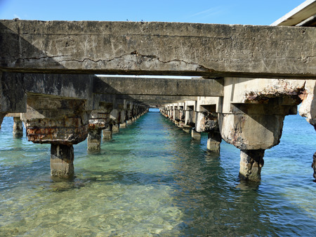 Photo from the underside of a pier that is deteriating