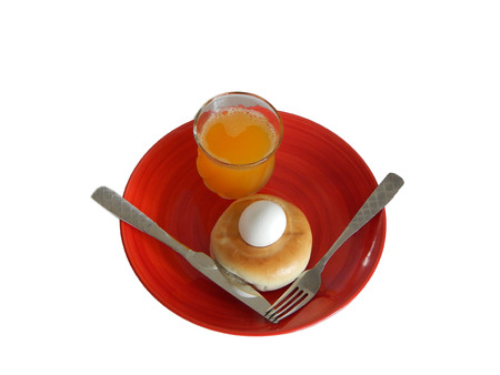 This is a photo of breakfast on a round red plate on a white background