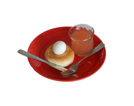 This is a photo of breakfast with juice on a round red plate Stock Photo