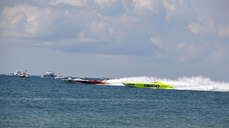 CLEARWATER, FLUSA - SEPTEMBER 28:  Super boats GEICO, Hooters, and Twisted Metal competing in an offshore race on September 28, 2014 in Clearwater Florida Editorial