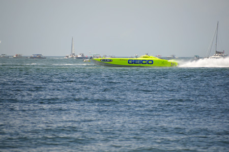 super yacht: CLEARWATER, FLUSA - SEPTEMBER 28:  Super boat GEICO taking a warmup run prior to competing in an offshore race on September 28, 2014 in Clearwater Florida