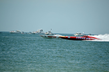 This is a photo of super boat Hooters vs Lucas Oil  in an offshore race