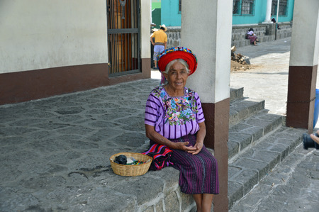 ANTIGUA, GUATEMALA - JULY 1, 2015; An unknown elderly Guatemalan woman selling her trinkets at the local market Editorial