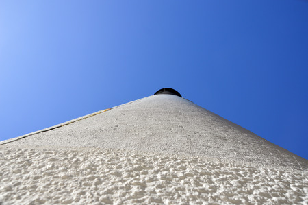 A photo of the outside of a lighthouse looking up