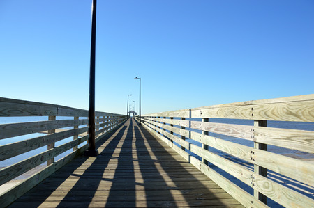Pier leading into a cloudless sky