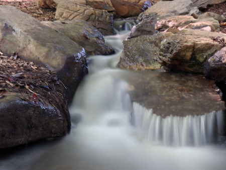 A waterfall in a small stream frozen in time as water flows over several levels