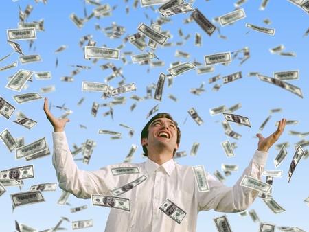 man catching falling dollars