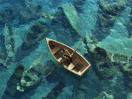 Boot segelt durch den Friedhof von versunkenen Schiffen