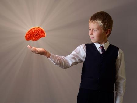 brain and thinking: glowing brain of the child hand Stock Photo