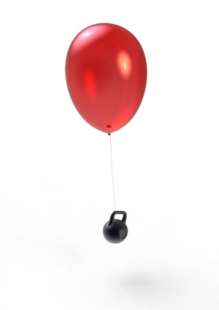 gravity: flying balloon and heavy weight Stock Photo