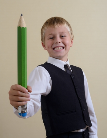 brave schoolboy with big pencil Stock Photo - 15687983