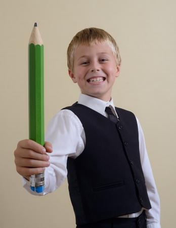 brave schoolboy with big pencil Stock Photo