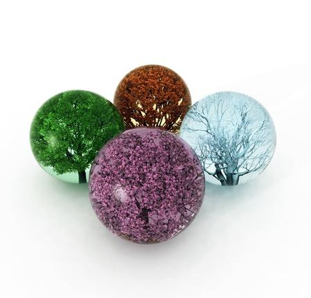 cuatro elementos: árboles de cuatro temporadas en las gotas Foto de archivo