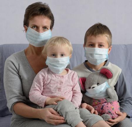 Family in protective masks Archivio Fotografico