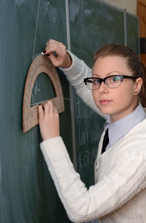 protractor: woman with a protractor to the blackboard