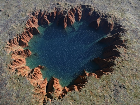crater lake: heart-shaped crater with a lake inside Stock Photo