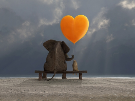 big and small: elephant and dog holding a heart shaped balloon Stock Photo