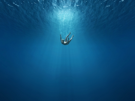 drown: Man falls into the depths Stock Photo