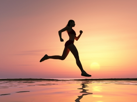 female athlete: Woman running on the beach Stock Photo