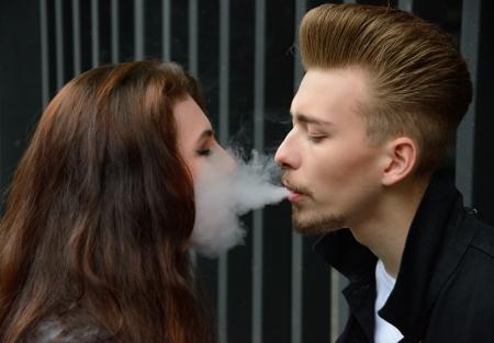 smoking mouth to mouth Фото со стока