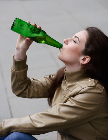 tipsy: woman drinking beer from the bottle Stock Photo