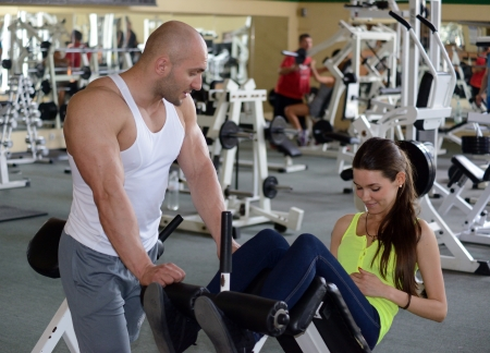 Personal Trainer in gym Stock Photo