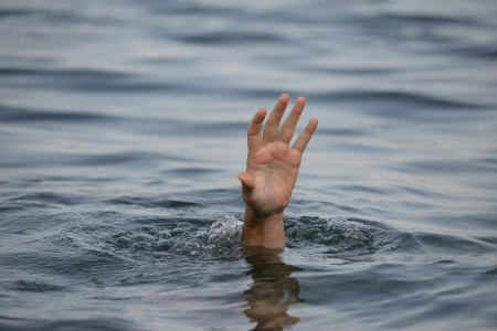 business survival: hand drowning Stock Photo