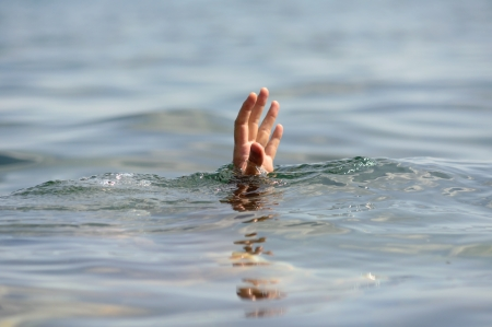 drowning: hand drowning  Stock Photo