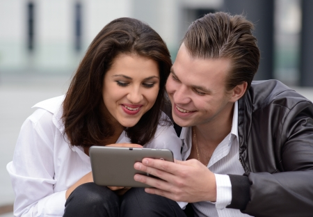 computer user: young couple using tablet