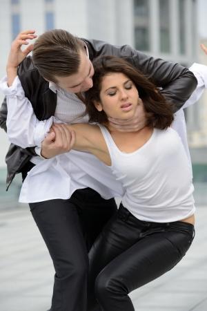 wrestle: emotional fight between men and women Stock Photo