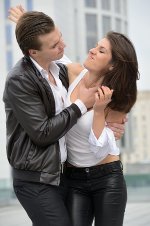to strangle: emotional fight between men and women Stock Photo