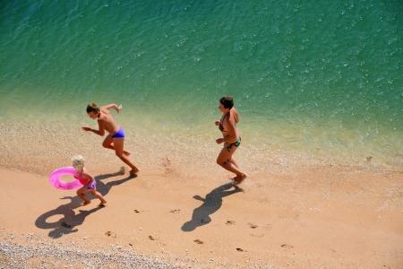family play on a beach photo
