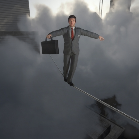 Businessman walking on Tightrope photo
