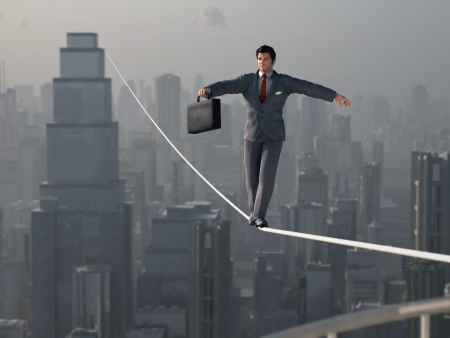 Businessman walking on Tightrope Banco de Imagens