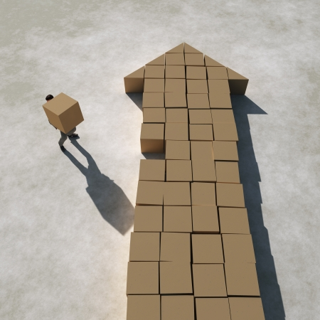 businessman builds arrow