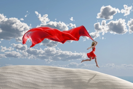 well being: woman with a red tissue on the beach