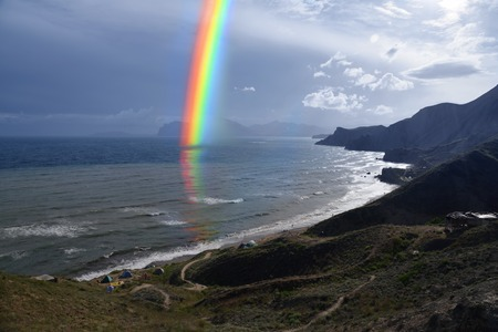 sea rainbow after the storm photo