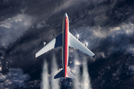 above the clouds: airplane flying above clouds