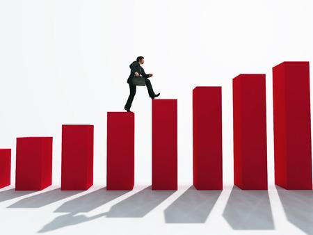 businessman running: businessman running up the stairs Stock Photo