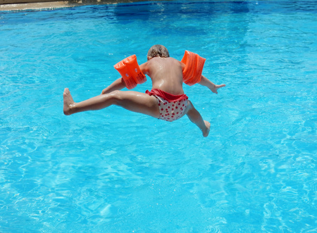 armbands: little girl jumping into the pool