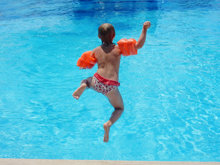 armlet: little girl jumping into the pool
