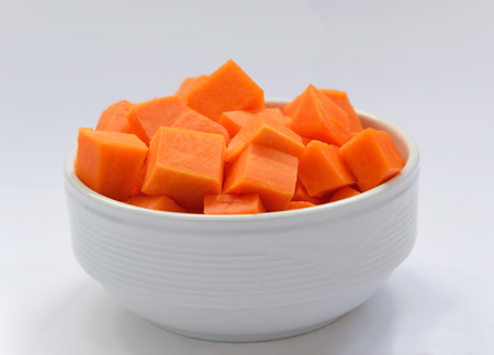 diced: diced pumpkin in a white plate Stock Photo