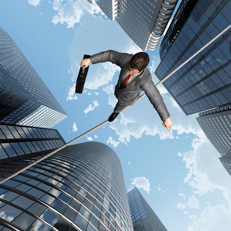 zakenman balanceren op een koord Stockfoto